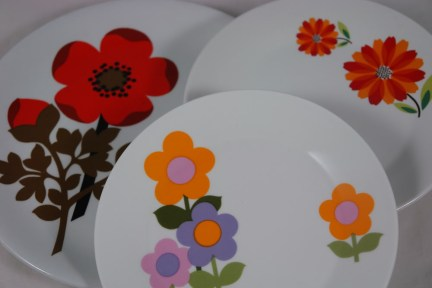 Trio of plates with floral decoration