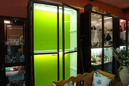 H is for Home shop cabinet freshly painted with lime green background