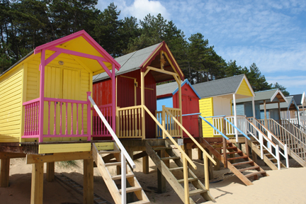 Colourful beach huts on the beach between Wells-next-the-Sea and Holkham | H is for Home