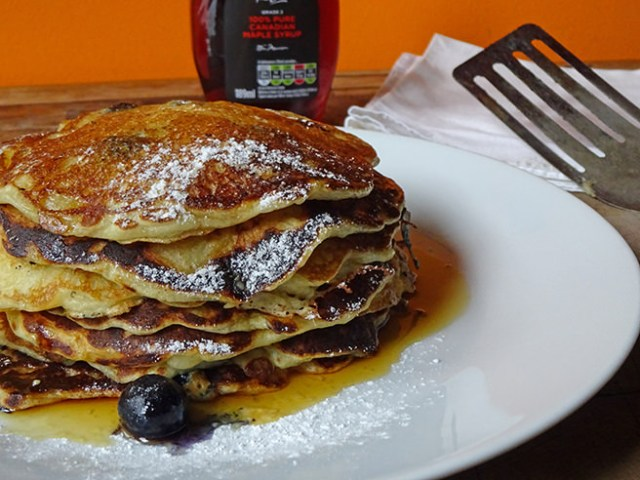 Stack of home-made buttermilk pancakes with blueberries and maple syrup   H is for Home