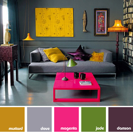Grey sitting room with hot pink and mustard yellow furnishings
