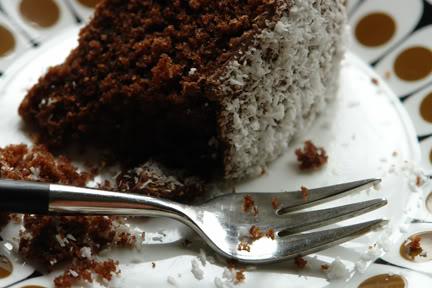 close up of chocolate sponge cake on vintage John Russell Black Velvet plate with vintage Joseph Rogers cake fork