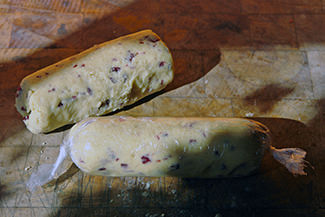 Home-made macadamia nut & cranberry cookie dough batons wrapped in cling film | H is for Home