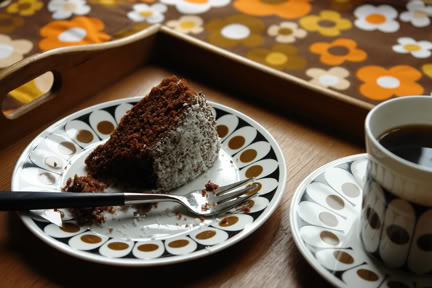 slice of chocolate sponge cake with dessicated coconut topping on vintage John Russell Black Velvet plate with coffee in matching cup & saucer | H is for Home