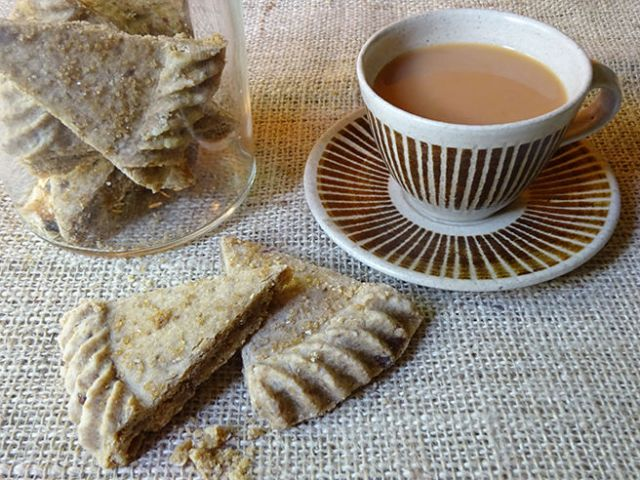 Home-made mMscovado shortbread petticoat tails with cup of tea
