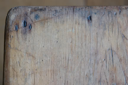 showing the worn edge of the miniature pine table