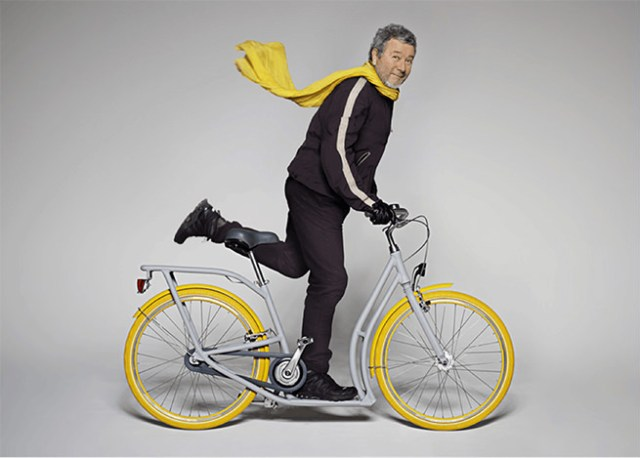 Philippe Starck on a 'Pibal' scooter-cycle he designed in collaboration with Peugeot