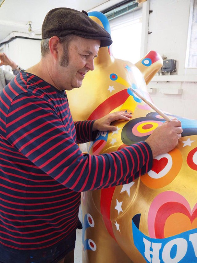Portrait of Sean Sims painting his Snowdog