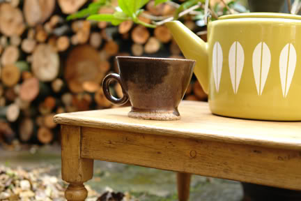 miniature table with Catherineholm Lotus kettle and studio pottery mug