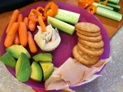 Theo's dinner: veggies, avocado, hummus, crackers and sliced chicken