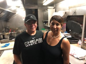Ruben Hernandez and his daughter in Ruby's Taco Truck