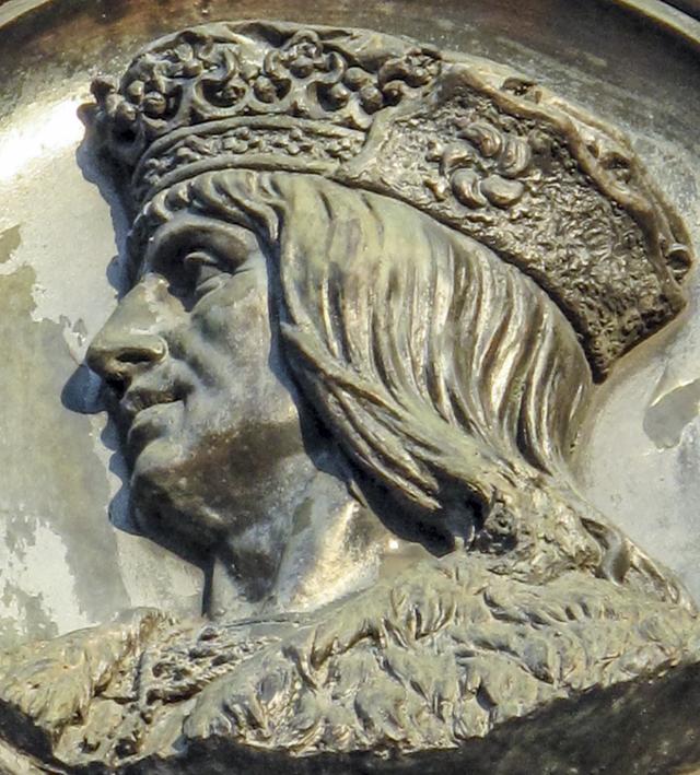 Història de Catalunya . Medellà de Ferran II al monument a Colom de Barcelona