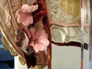 Detail of garland of pink and maroon pressed-velvet petals and silk tulle on a wire frame pinned inside the brim, 1840s.