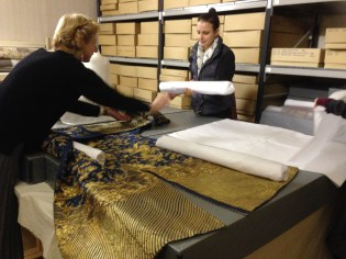 Althea Mackenzie & Claire Tremlett, Costumier in Residence 2014, packing exhibition items away at Berrington Hall