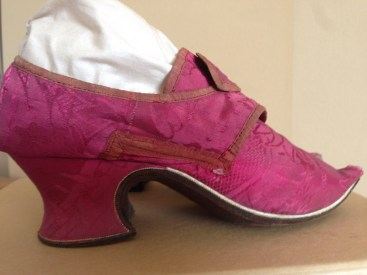 1740s Raspberry silk upper and heel cover, brown leather soles. Charles Paget Wade costume collection, stored at Berrington Hall