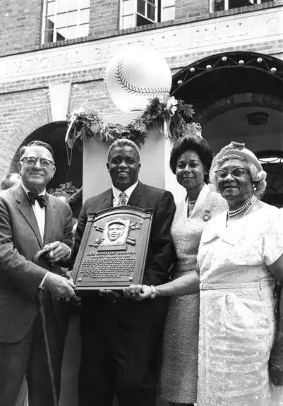 Jackie Robinson with Branch Rickey, wife Rachel and mother Millie