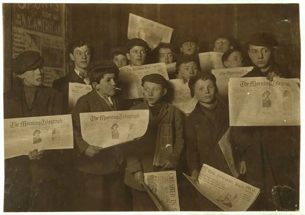 Paper boys at 2 A.M. getting ready of the morning rounds, 1908.