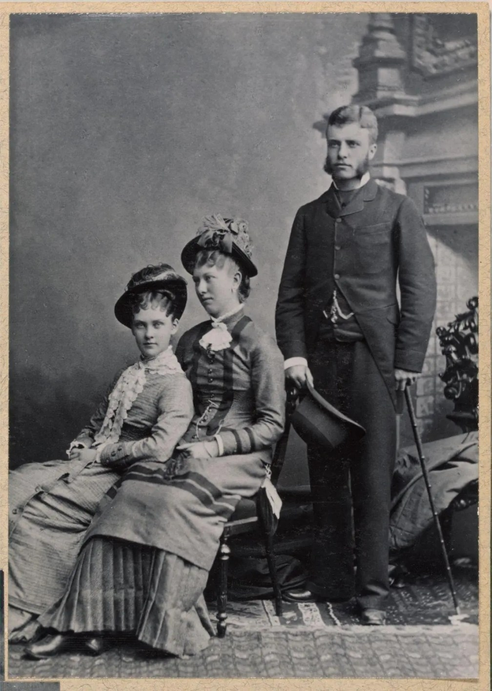 A formal portrait of (from left to right) Alice Hathaway Lee, her cousin Rose Saltonstall, and Theodore Roosevelt.