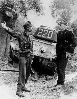 Panzer drivers by a destroyed Russian T-34.