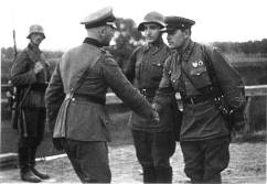 German and Soviet troops shaking hands following the invasion.