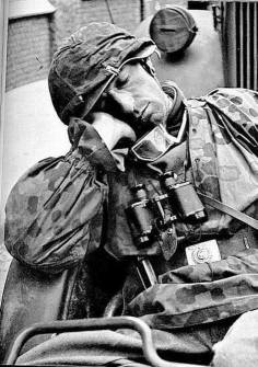 Soldier of the Waffen SS sleeping. He should be member of the 31st SS Volunteer grenadier Division.