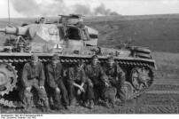 The crew of a Panzer III of the 2nd SS Panzer Division Das Reich rest during the Battle of Kursk.