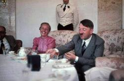 Hitler entertaining guests.