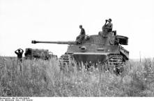 The conditions during the battle were hot and humid. Here, Alfred Kurzmaul, of the 503rd Heavy Panzer Battalion, drinks water aboard a Tiger I during a lull in the fighting.