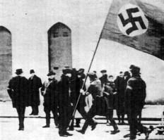 1941, Vrsac,Banat, Yugoslavia ( today Serbia )-Folkdeutschers raising the flag in the city center.