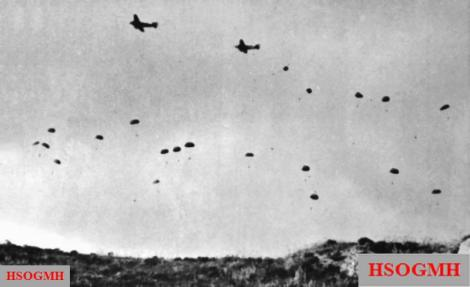 German paratroopers jumping from Ju 52s over Crete.