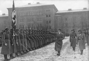 A December 1935 parade for Adolf Hitler at the Leibstandarte SS Adolf Hitler Barracks. Sepp Dietrich is on the far right.