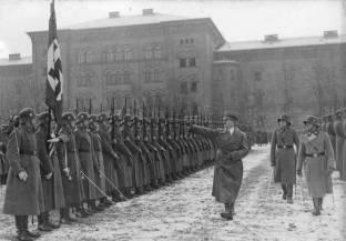 A December 1935 parade for Adolf Hitler at the Leibstandarte SS Adolf Hitler Barracks. Sepp Dietrich is on the far right.
