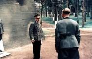 Adolf Hitler (Führer und Reichskanzler des Grossdeutschen Reiches) in front of a newly built bunker at his Führerhauptquartier 'Wolfsschanze' near Rastenburg, East Prussia, 18 September 1944. With the back to the camera is his personal adjutant, SS-Obersturmführer Otto Günsche.