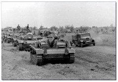 August 1942, Stugs and support trucks approach Stalingrad.