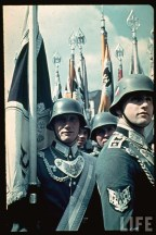 The picture was taken in Berlin at the military demonstration for Hitler's 50th birthday (Führergeburtstag), 20 April 1939. These Fahnenträger are from Infanterie-Regiment 102 led by Oberst Stephan Rittau, latter Generalleutnant.