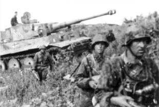 2nd SS Panzer Division soldiers, Tiger I tank, during the battle.