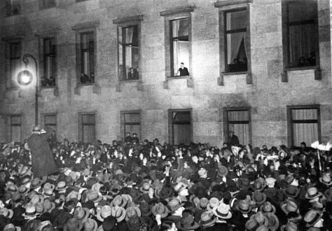 Hitler, at the window of the Reich Chancellery, receives an ovation on the evening of his inauguration as chancellor, 30 January 1933.