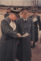 Adolf Hitler and Reichsminister Joachim von Ribbentrop. In the back is SS-Obergruppenführer Otto Dietrich.