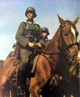 """This German soldier is preparing to move further after a rest, 1941. With him one of the millions of horses who did their """"duty"""" for Wehrmacht in World War II. The soldier is holding a plucked chicken and his k98 rifle is slung on his shoulder."""
