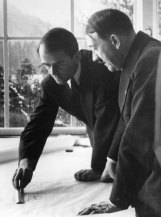 German architect Professor Albert Speer showing German dictator Adolf Hitler (right) some of his plans for Berlin's new outline and buildings. (Photo by Norman Smith/Getty Images)