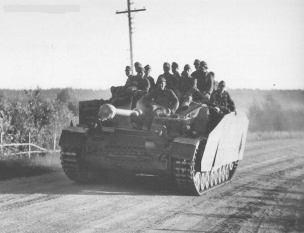 StuG IV of assault gun Department 1122 and sit on infantry in Viipurinlahti, Finland 1944.