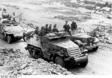 Rommel speaks with troops who are using a captured American M3 half-track, Tunisia.