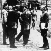 At Rastenburg on 15 July 1944. Stauffenberg at left, Hitler center, Keitel on right. (The person shake-handed by Hitler is the General Karl Bodenschatz, who five days later, in contrast to Hitler, was heavily injured by Stauffenberg's bomb.)