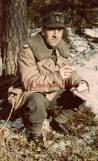 A wartime Agfa color slide of a Gebirgsjäger Hauptmann eating some bread ration.