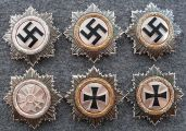 German Cross in Silver, Gold, and with Diamonds. Post-war de-nazified versions below.