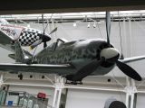 An Fw 190 A-8 (W-Nr:733682) at the Imperial War Museum showing faired-over gun ports and a belly-mounted ETC-501 bomb rack. This Fw 190 was used as the upper component for a Mistel flying bomb.