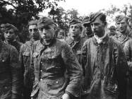German soldiers of the 12th Panzer Division Hitlerjugend taken prisoner in Normandy.