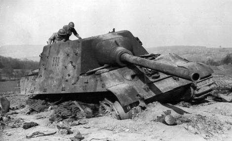 Destroyed Jagdtiger being looked over by allied troops.
