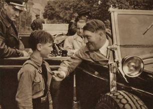 Hitler talking to a youth member.