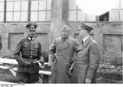 Benito Mussolini with Hitler and Field Marshall Gerd von Rundstedt.